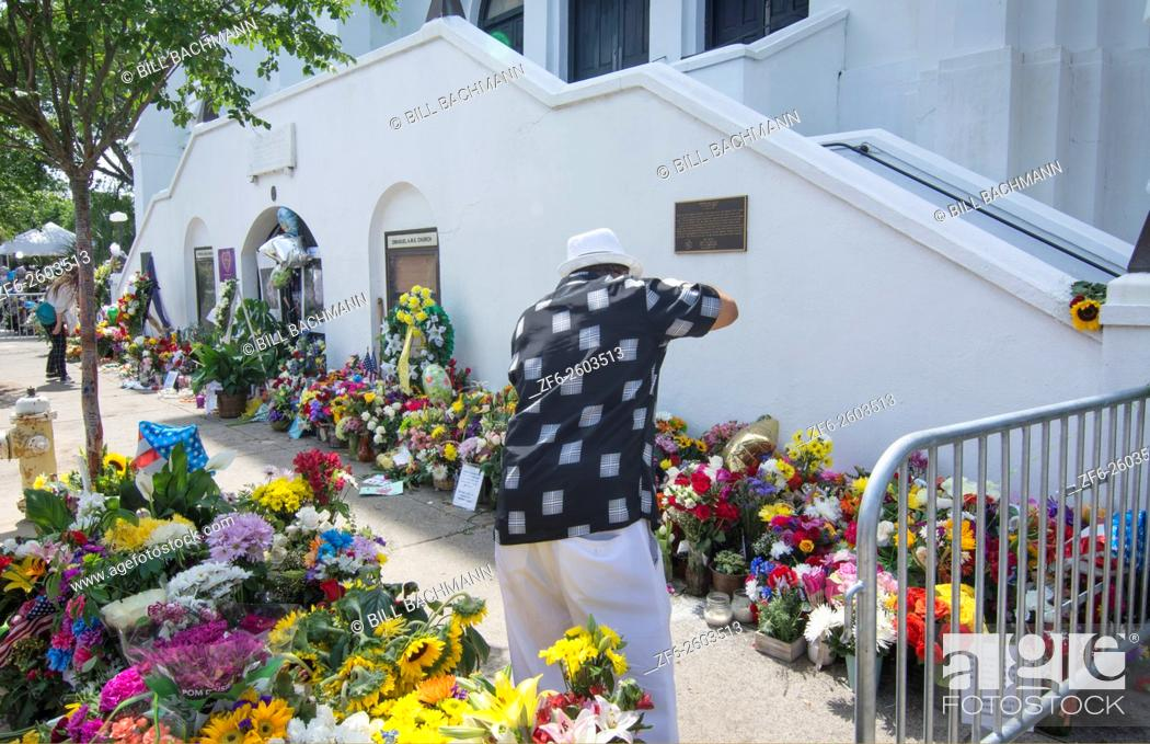 Stock Photo: Famous Emanuel A. M. E. Church in Charleston South Carolina black church people leaving flowers and messages and taking pictures of the scene of horrible murder.