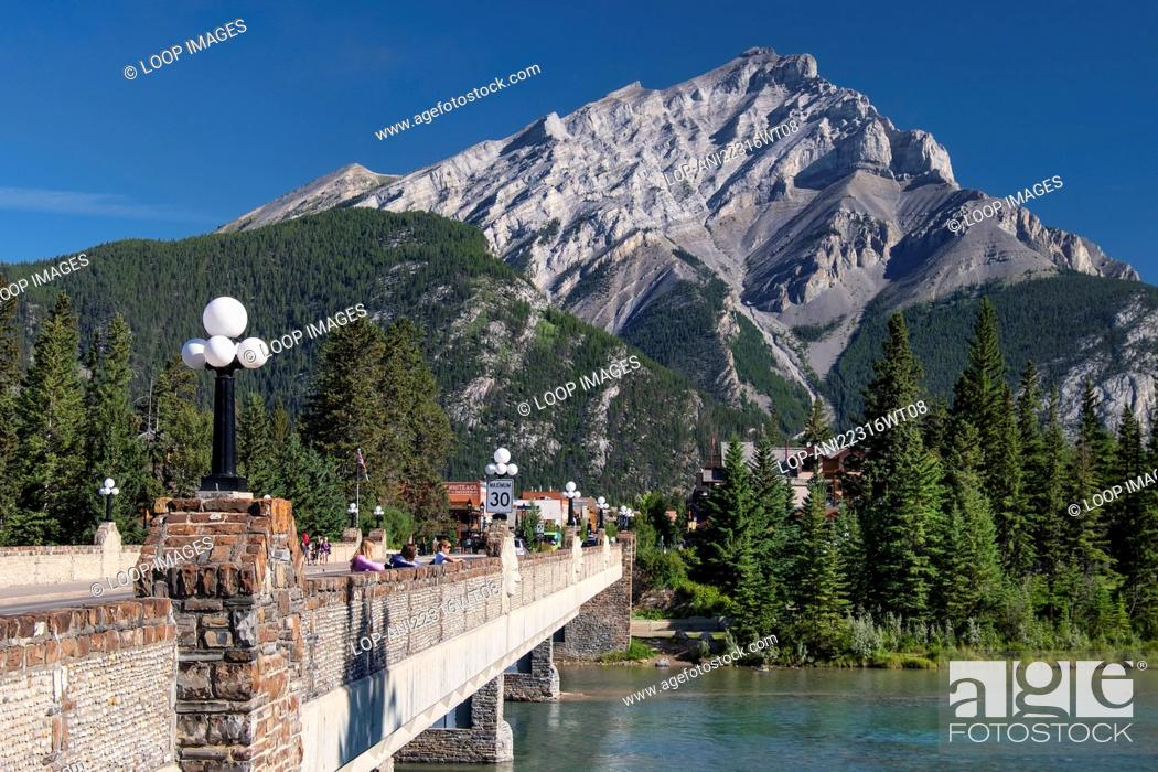 Stock Photo: Bow River Bridge with Bow River and Cascade Mountain in Banff in the Canadian Rockies.