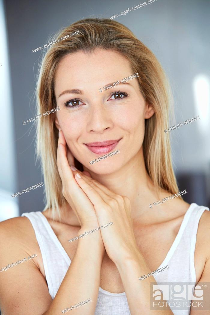 Stock Photo: Portrait of smiling blond woman.