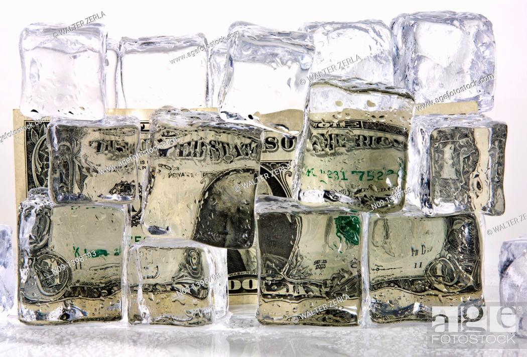Stock Photo: Dollar and ice cubes.