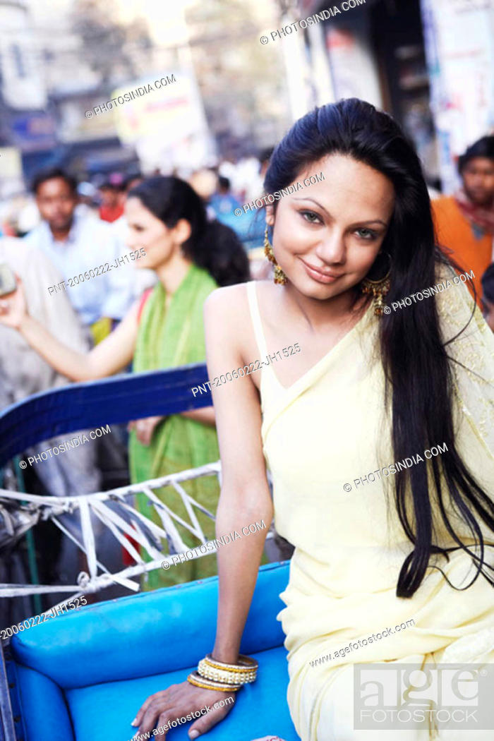 Stock Photo: Portrait of a young woman sitting in a rickshaw.