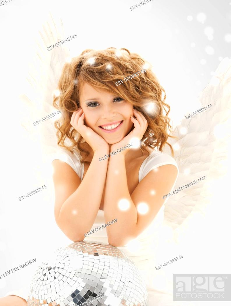 Stock Photo: holidays and costumes concept - happy teenage angel girl with disco ball.