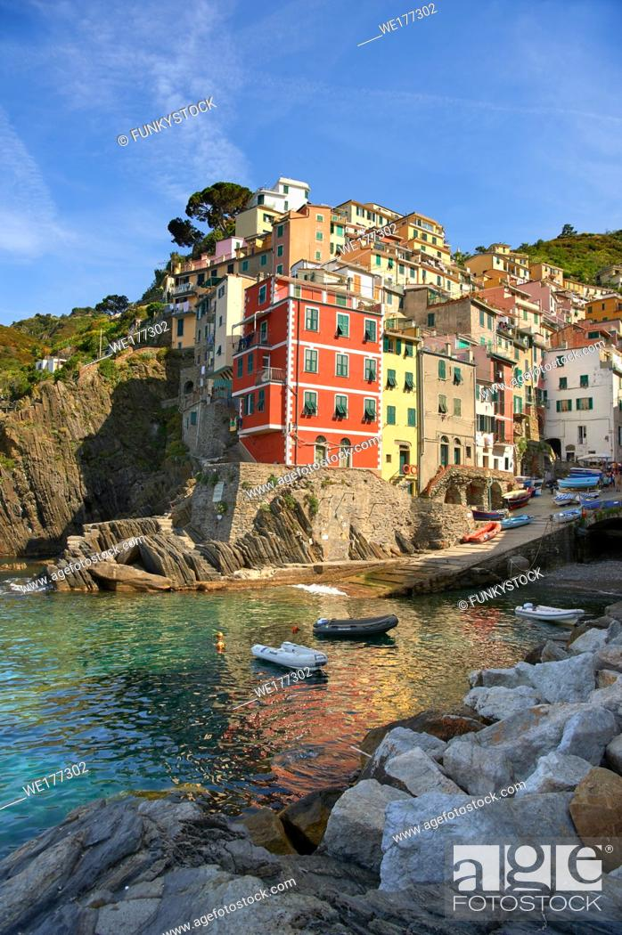 Stock Photo: Fishing village and harbour of Riomaggiore at sunrise, Cinque Terre National Park, Liguria, Italy.