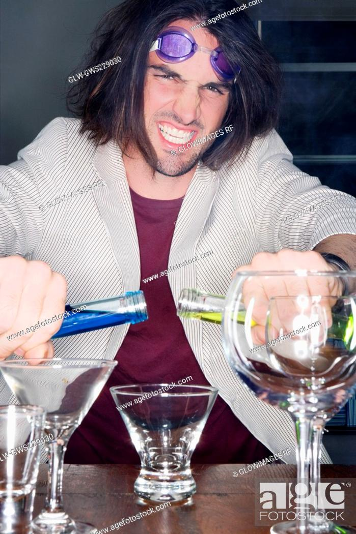 Stock Photo: Portrait of a young man making a cocktail.