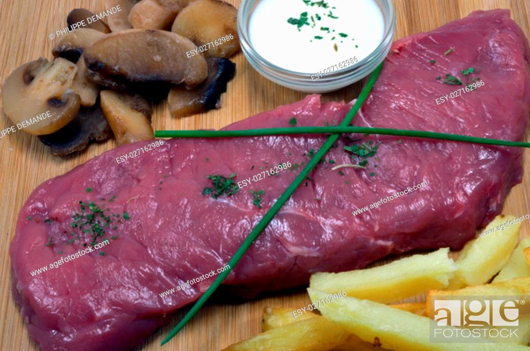 Stock Photo: Steak of very red ox with its cream, its French fries and his mushrooms.