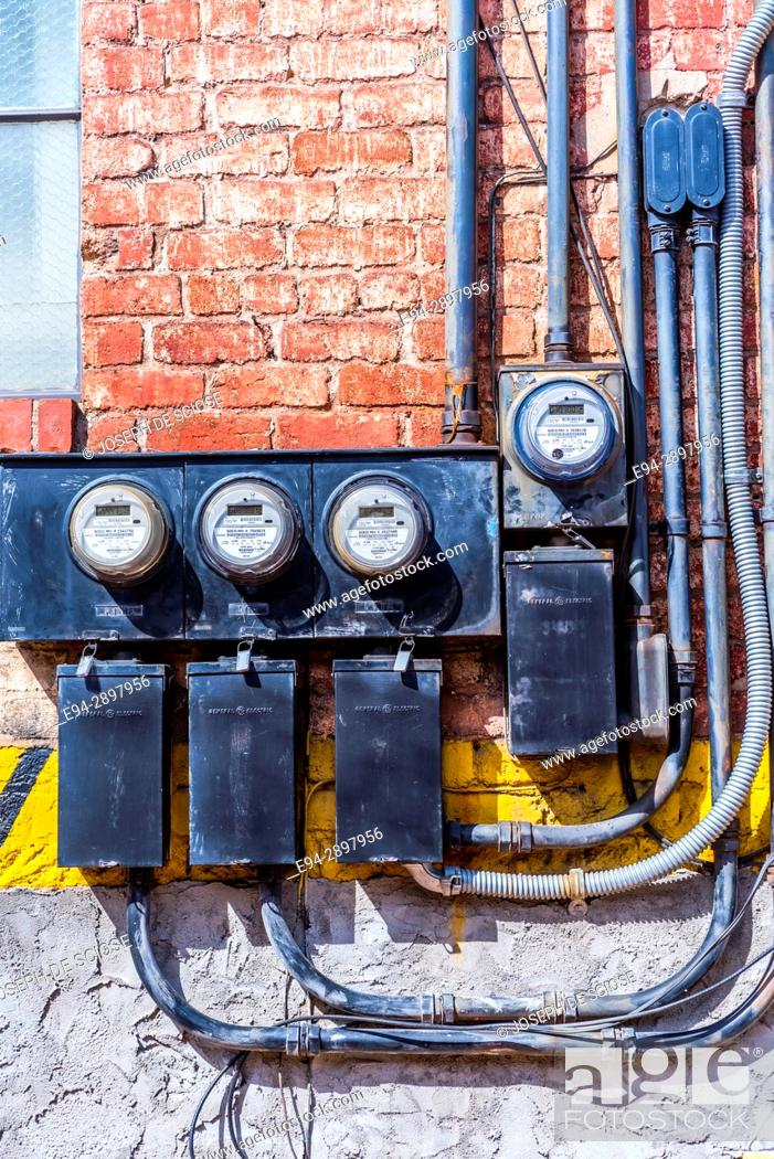 Groovy Electric Meters Fuse Boxes And Cables Mounted On A Brick Wall On Wiring Digital Resources Indicompassionincorg