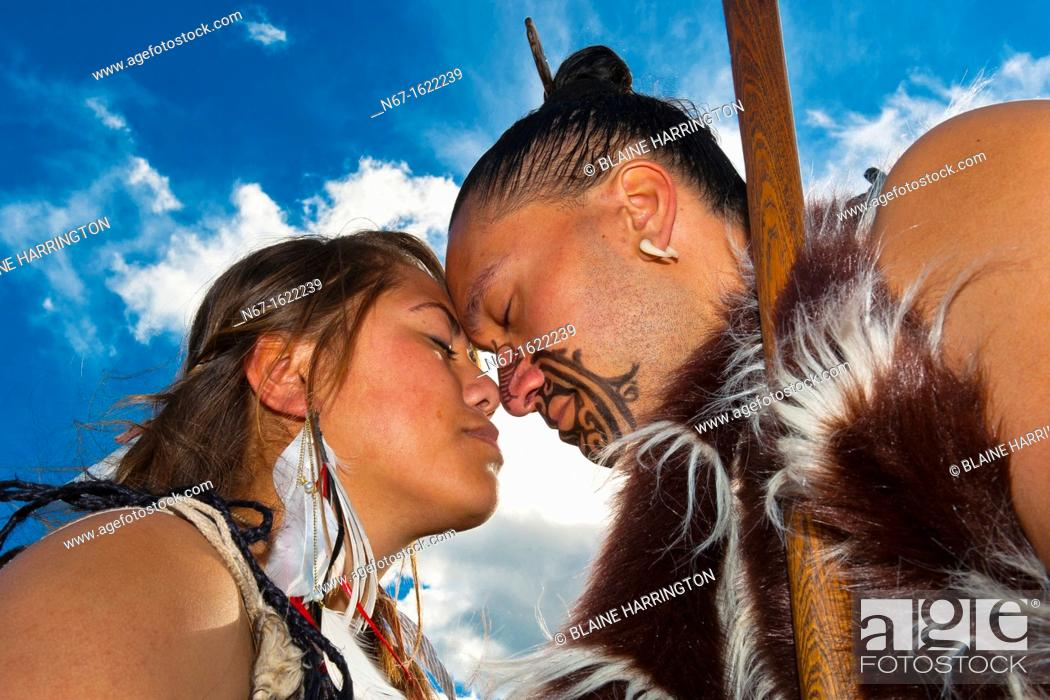 Maori Greeting Hongi: A Maori Man With Ta Moko Facial Tattoo And Woman Doing