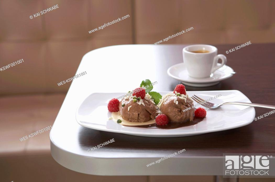 Stock Photo: Chocolate icecream with raspberry, espresso in background.