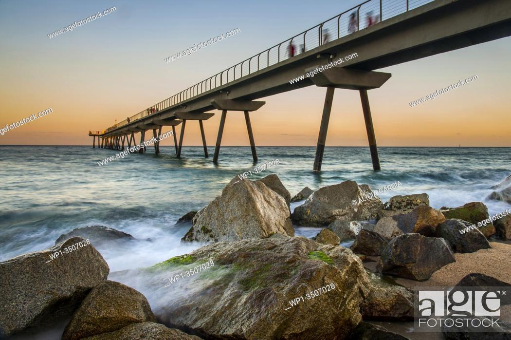 Stock Photo: badalona bridge at sunset with the sea in motion.