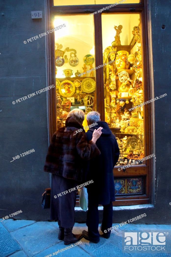 Stock Photo: Couple in front of shop in the old town of Siena, Tuscany, Central Italy.