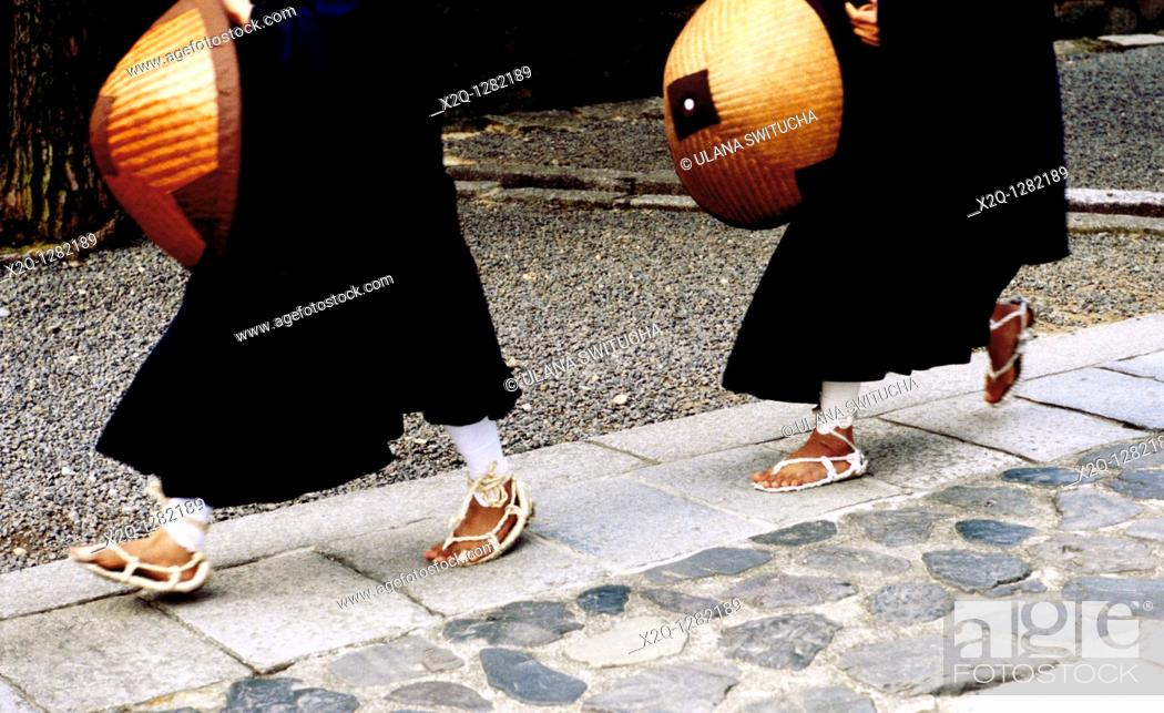 Stock Photo: Shinto Monks wearing straw sandals at Daitokuji in Kyoto Japan.