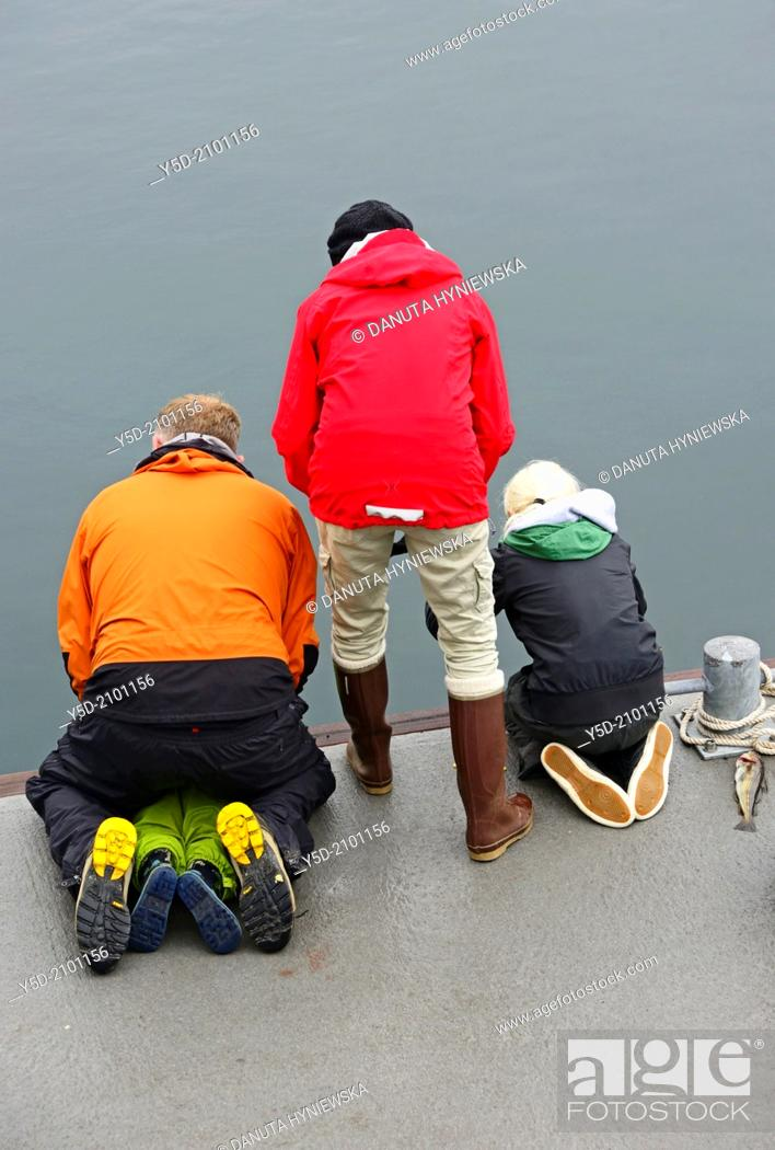 Stock Photo: Icelandic people love to fish directly from waters of Atlantic Ocean, they don't even need a rod for fishing, they just fish using very simple tool - piece of.