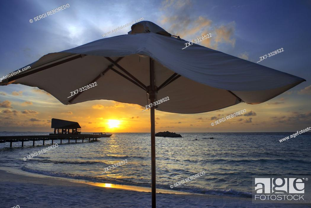Stock Photo: Sunset at the beach in The Residence Hotel and Resort, Gaafu Alifu Atoll. Maldives Islands.