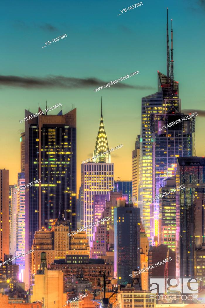 Stock Photo: The Chrysler Building, Bank of America Tower, and other buildings near 42nd Street in New York City during morning twilight as viewed over the Hudson River.