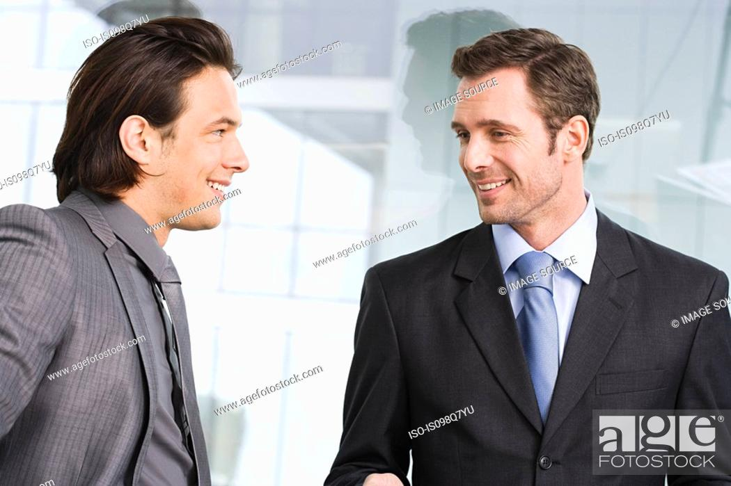 Stock Photo: Businessmen in office.