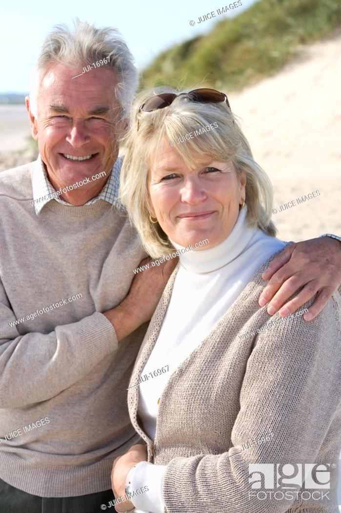 Stock Photo: Portrait of senior couple standing on beach.
