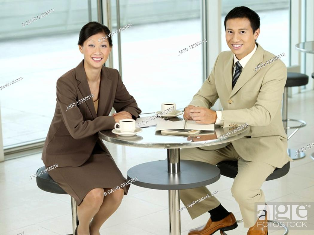 Stock Photo: Business colleagues Sitting at table portrait.
