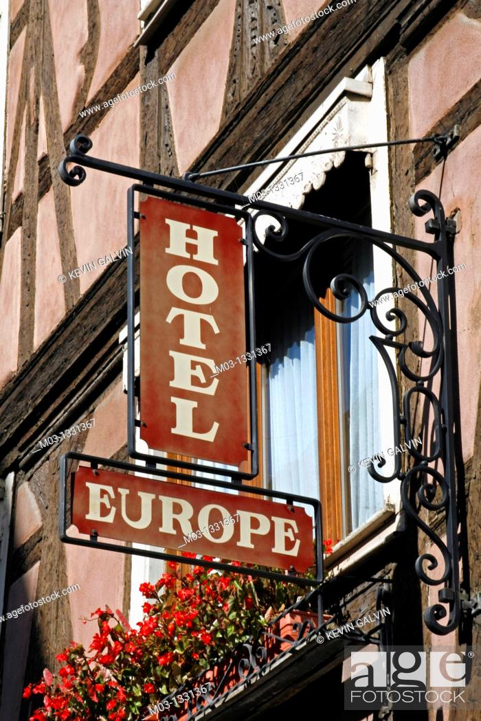 Stock Photo: France Alsace Strasbourg street scene signs Hotel Europe.