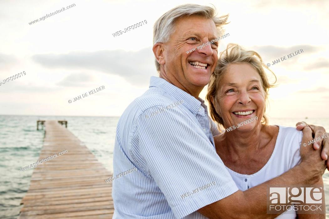 Stock Photo: Spain, Senior couple embracing at the sea.