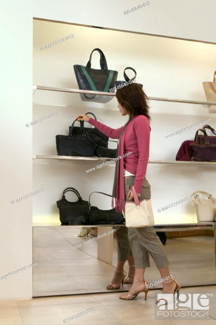 Stock Photo: Woman shopping for a handbag.