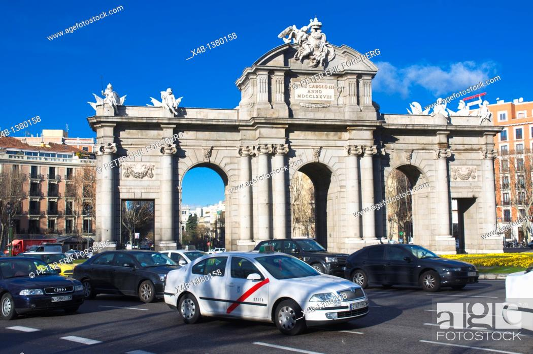 Stock Photo: Traffic at Plaza de la Independencia square roundabout central Madrid Spain Europe.