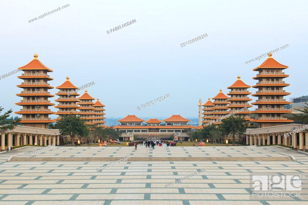 Stock Photo: Kaohsiung, Taiwan: Sunset at Fo Guang Shan buddist temple of Kaohsiung, Taiwan with many tourists walking by.