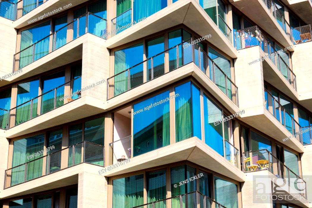 Stock Photo: Detail of a modern apartment building with floor-to-ceiling windows seen in Berlin, Germany.