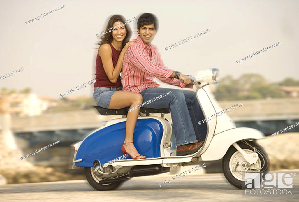 Stock Photo: Couple riding on scooter, Playa del Rey, California, United States.