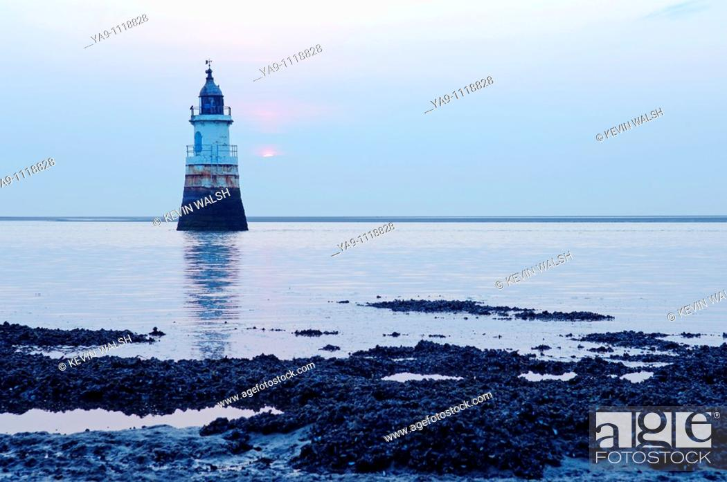 Stock Photo: Lighthouse in the River Lune channel near Cockerham Sands Lancashire England.