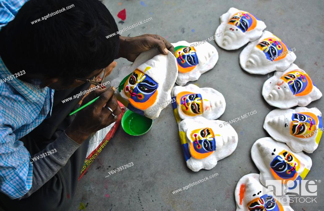Stock Photo: Craftsman making masks sold as souvenirs ( West Bengal, India).