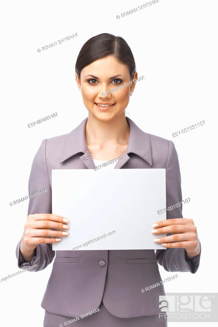 Stock Photo: Businesswoman holding an empty billboard over white background.