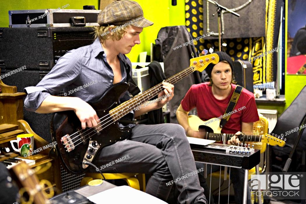 Stock Photo: Two young men playing music, Sweden.