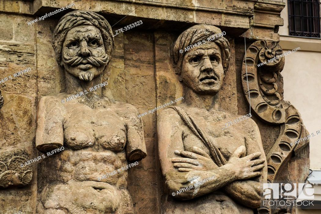 """Stock Photo: Detail of telamon sculptures representing """"""""Captive Moors"""""""" on façade of the New Gate (Porta Nuova) as seen from Independence Square (Piazza Indipendenza/Via."""