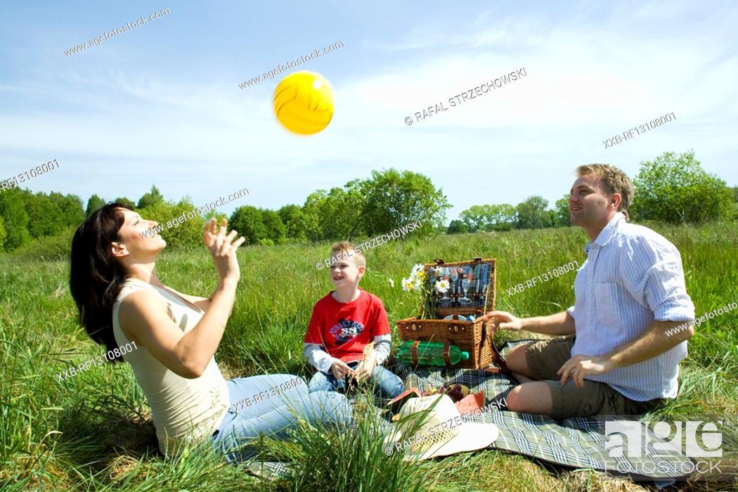 Stock Photo: family paying ball.