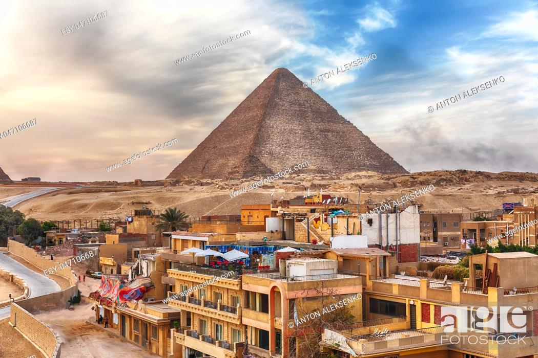 Stock Photo: The Pyramid of Cheops and Giza town nearby, Cairo, Egypt.