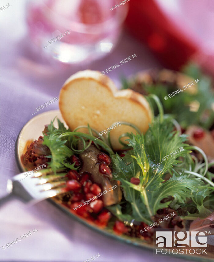 Stock Photo: Pomegranate and Baby Greens with Duck Liver.