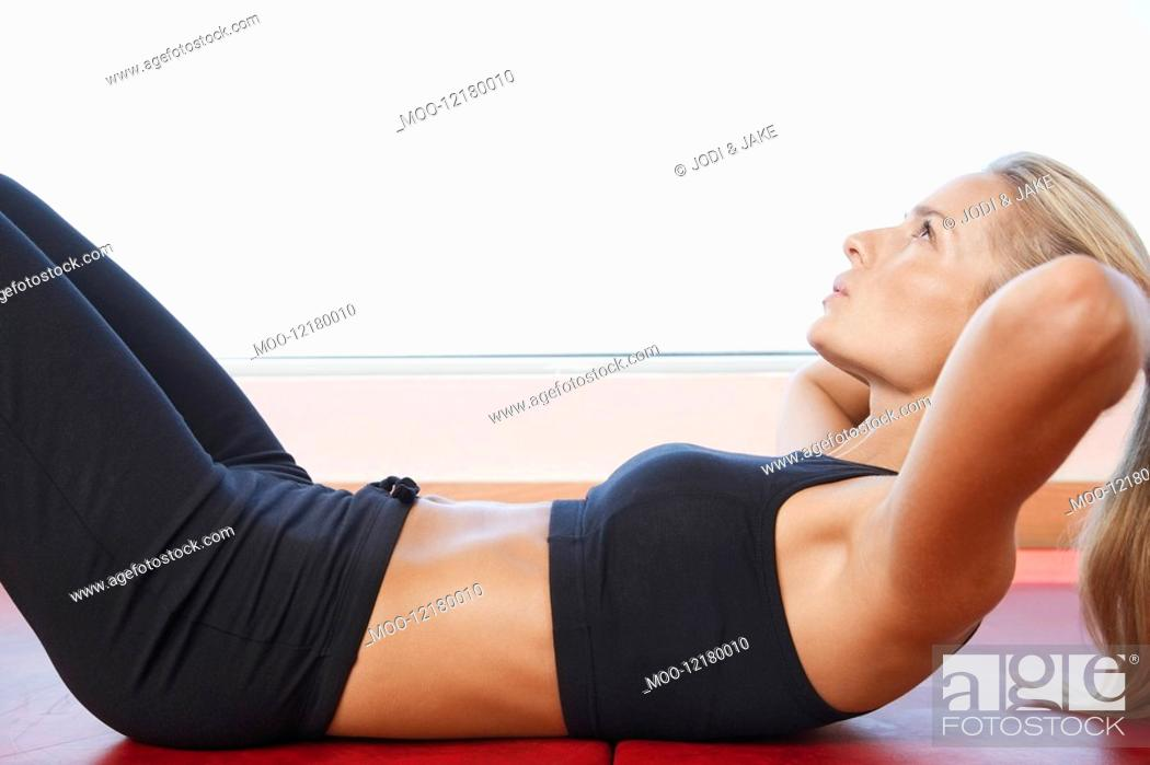 Stock Photo: Woman Doing Sit-Ups close up side view.