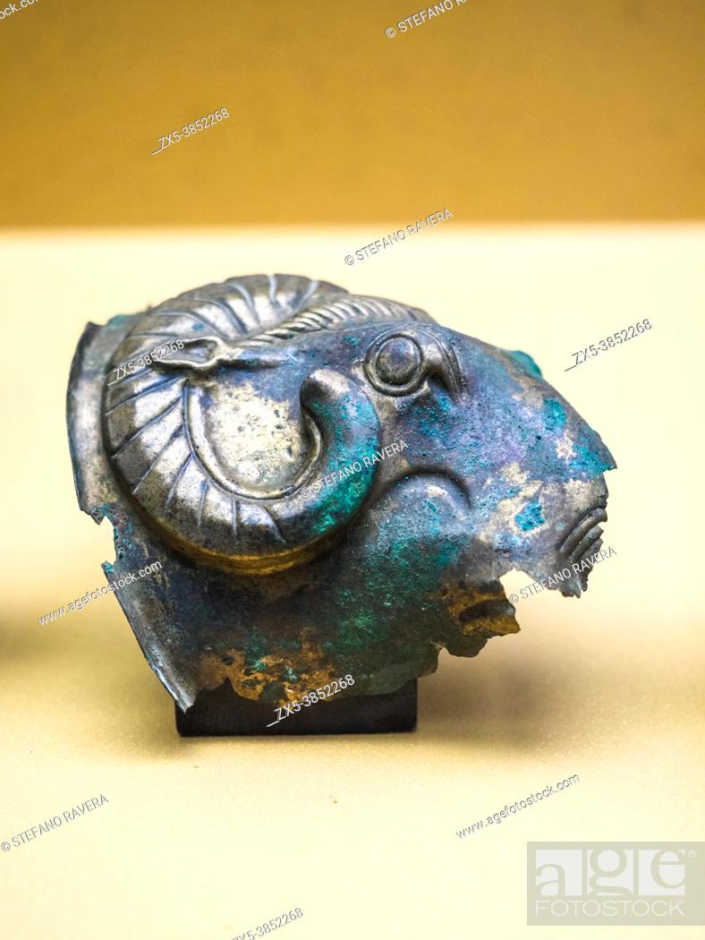 Stock Photo: Small bronze lacunars depicting a rams' head (late 6th - early 5th cent BC) - Tarquinia National Archaeological Museum, Italy.