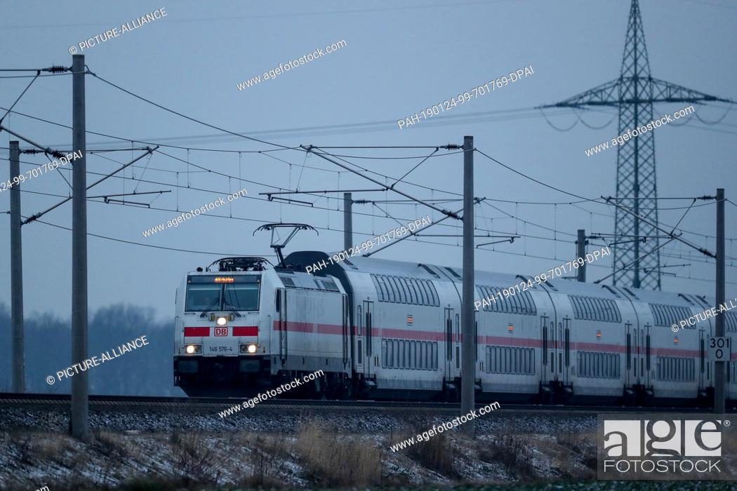 Stock Photo: 24 January 2019, Saxony, Leipzig: In the morning an IC (IC 2031 Hannover - Dresden) travels on a free route between Leipzig and Halle (Saale).