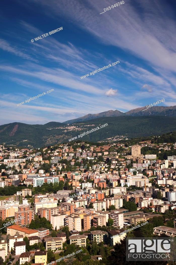 Stock Photo: Switzerland, Ticino, Lake Lugano, Lugano, high angle town view from Monte Bre, morning.