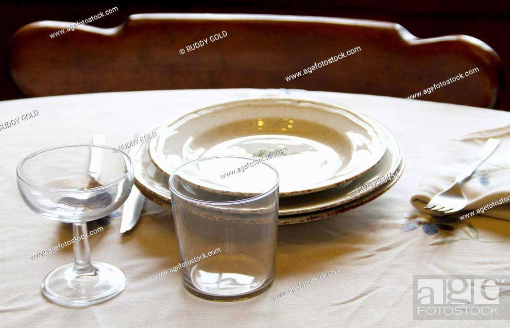Stock Photo: Table set with plates, cups, glasses, cover, tablecloth, spoons, forks and knives.