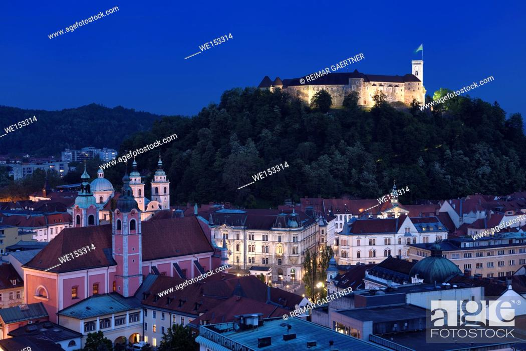 Stock Photo: Hlltop Ljubljana Castle overlooking the old town of Ljubljana capital city of Slovenia with Franciscan church and St Nicholas Cathedral at dusk twilight.