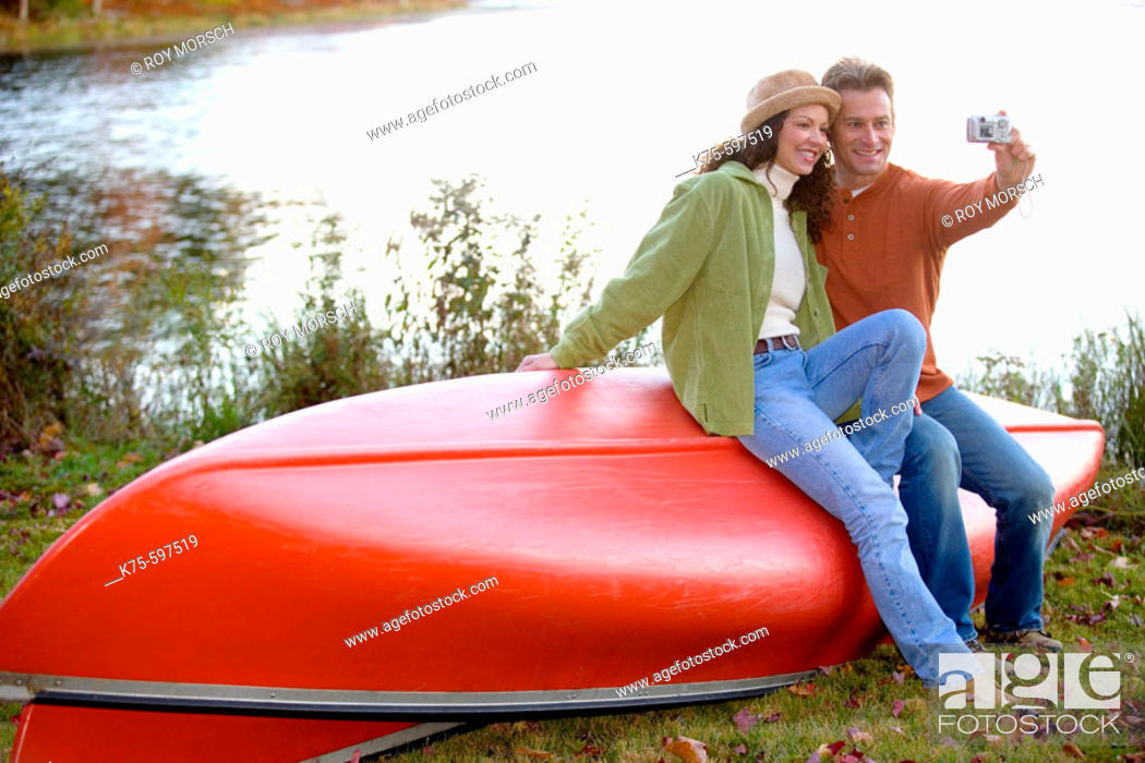 Stock Photo: Posing for the digital camera on the canoe.