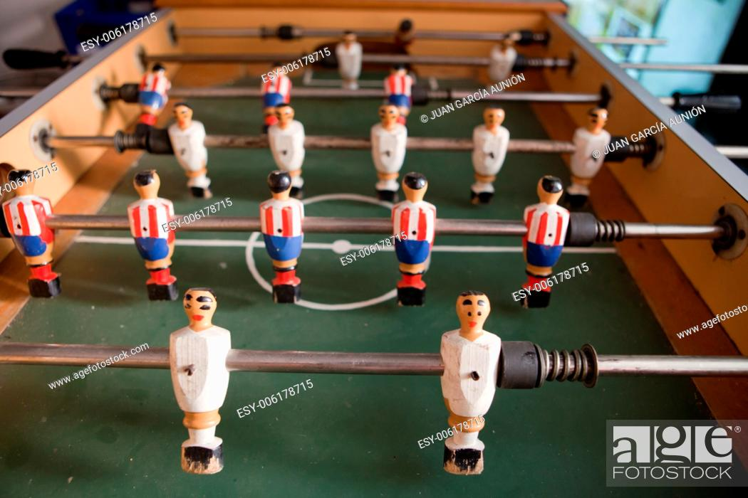 Stock Photo: A table for table football in the pub, visible figures of toy mini football players.