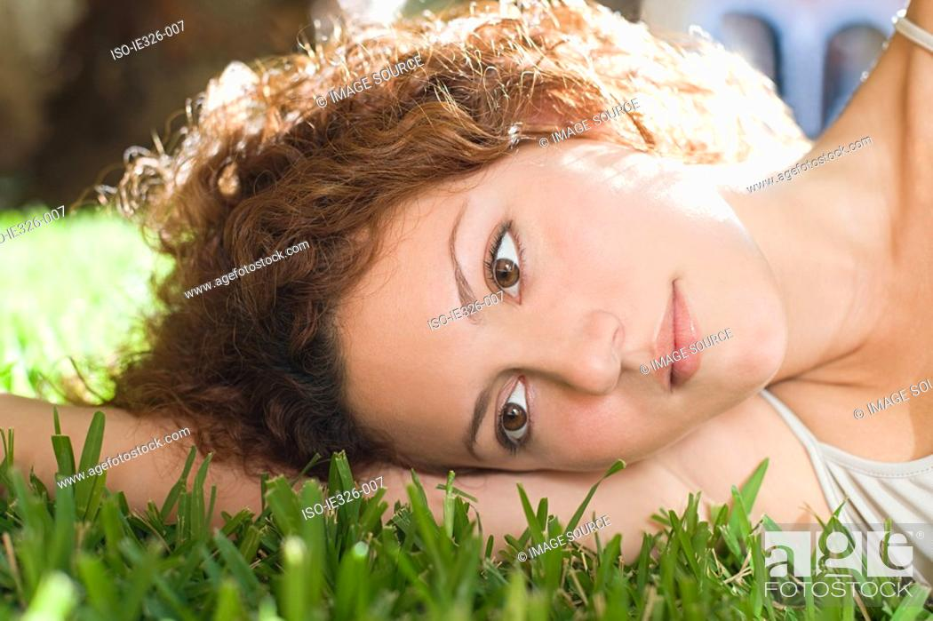 Stock Photo: Woman lying on grass.