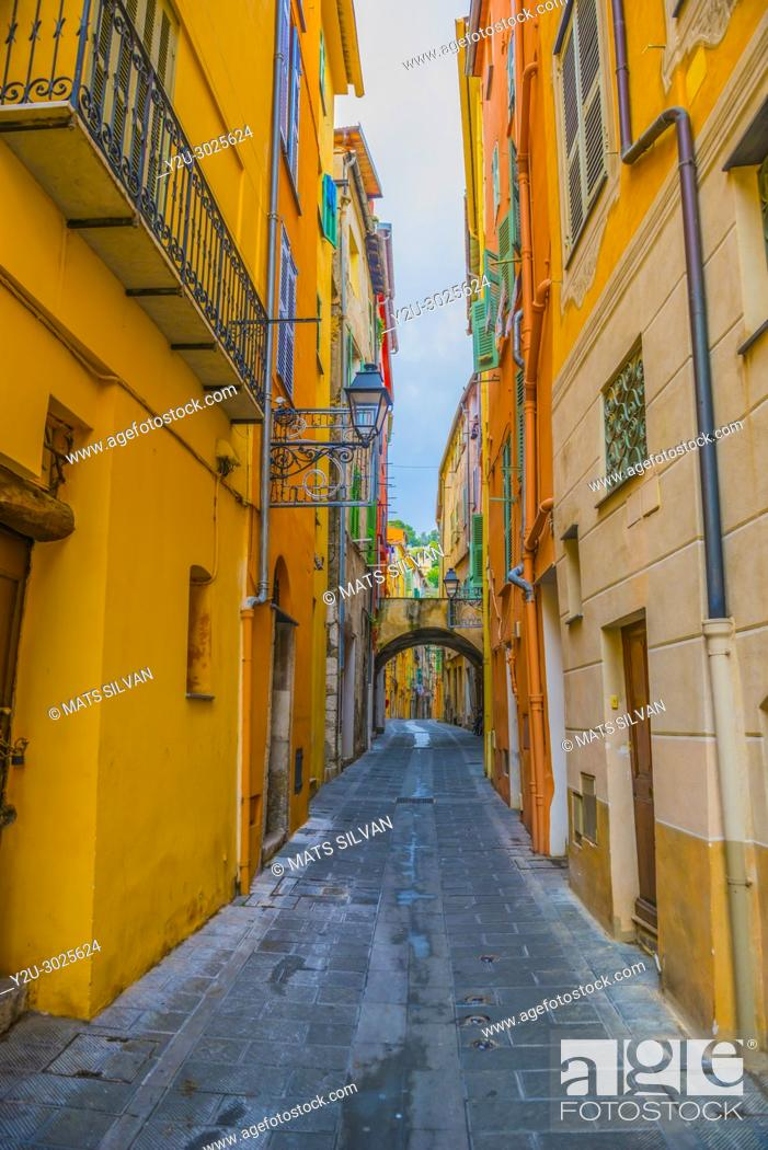 Stock Photo: Narrow Street in Old Town in Menton in Provence-Alpes-Côte d'Azur, France. .