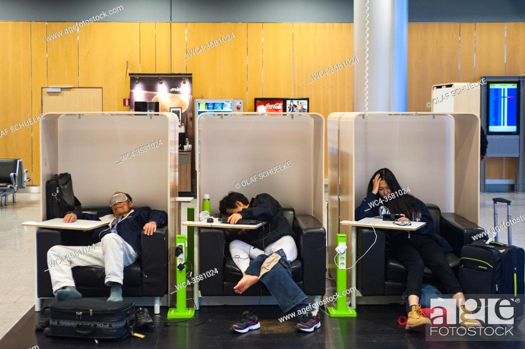 Stock Photo: Helsinki, Finland, Europe - Passengers wait for their departure flight to Asia at Helsinki's international airport Vantaa.