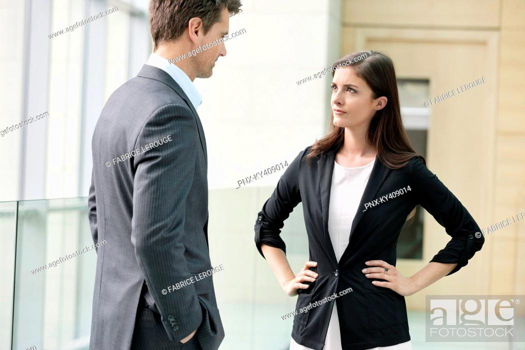 Stock Photo: Business executives discussing in an office.