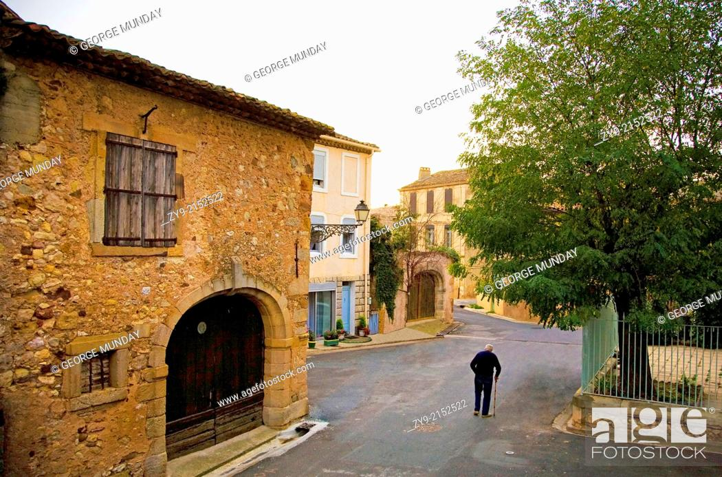 Stock Photo: Old Man in the Street, Cruzy, Languedoc-Roussillon, France.