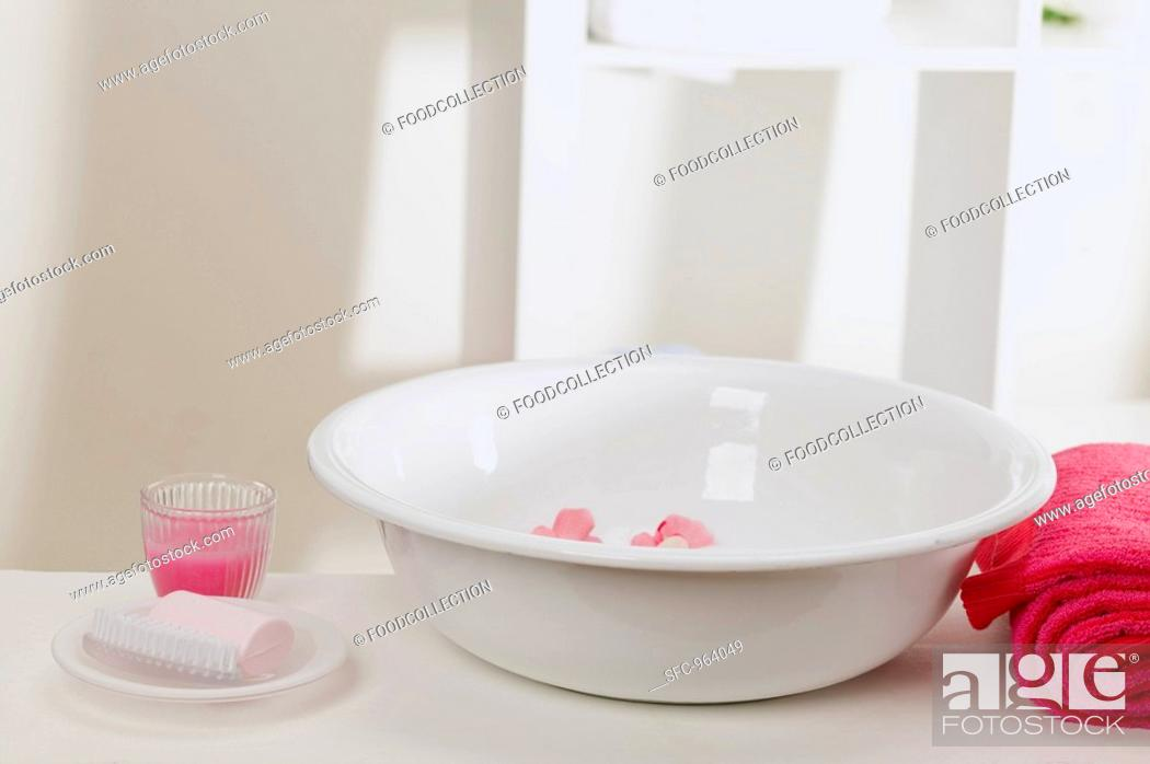 Stock Photo: Wash bowl with flowers, soap, towel and candle in glass.